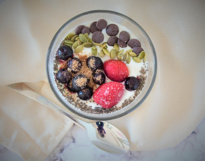 Whole milk plain Greek yogurt topped with berries, pumpkin seeds, chocolate chips, chia seeds & ground flaxseed.