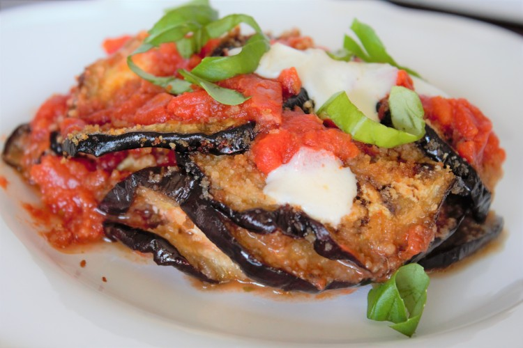 Eggplant lasagna made with baked eggplant, topped with tomato and fresh basil and mozzarella.