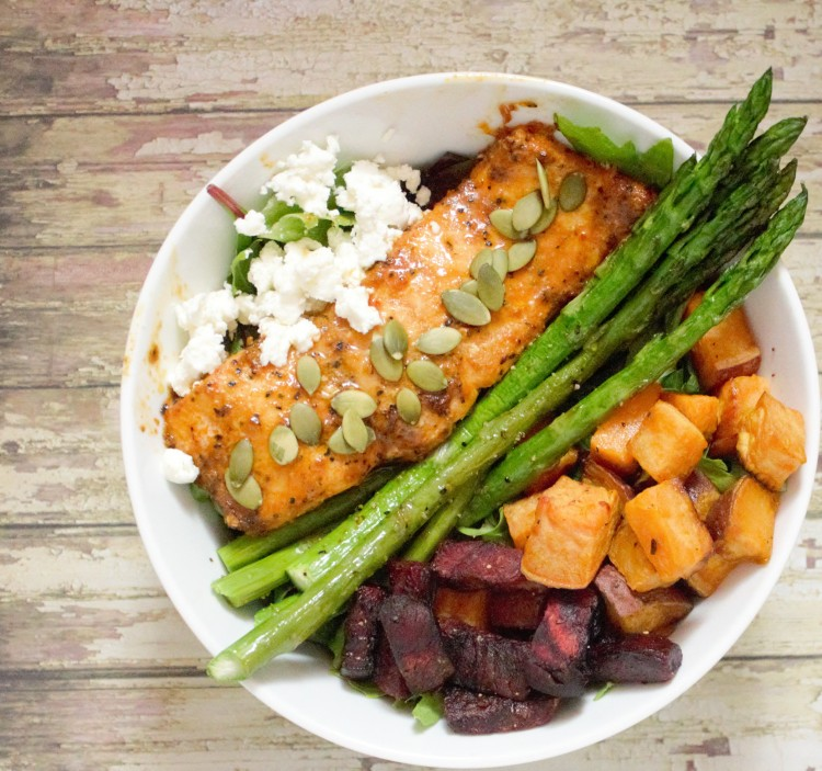 A delicious bowl of vegetables to include asparagus, beets, and lettuce with salmon and sweet potato on the side!