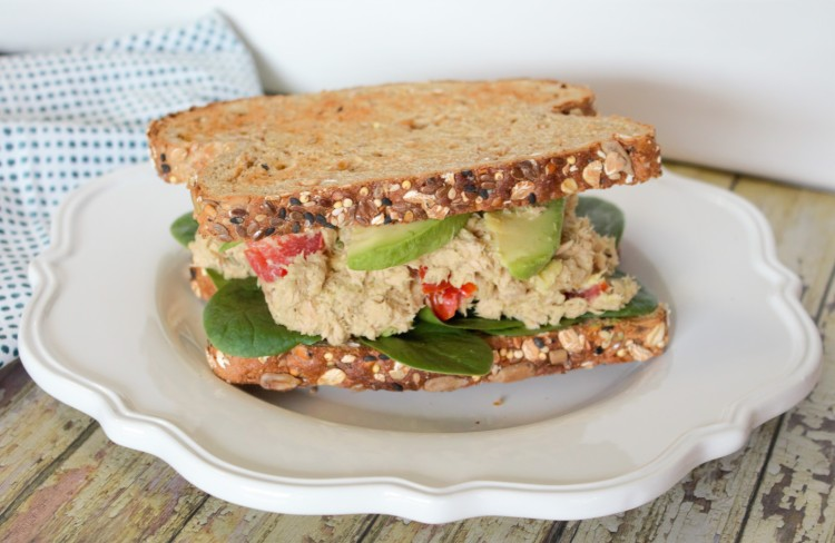 Flavorful & healthy tuna in a toasted whole wheat sandwich with spinach, tomato, and avocado.